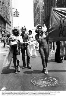 Silvia Rivera (with cooler) Marsha P Johnson (with banner)